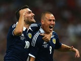 Kenny Miller of Scotland celebrates with team-mate Robert Snodgrass of Scotland after scoring a goal during the International Friendly match between England and Scotland at Wembley Stadium on August 14, 2013