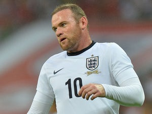 Rooney defends Hodgson over joke