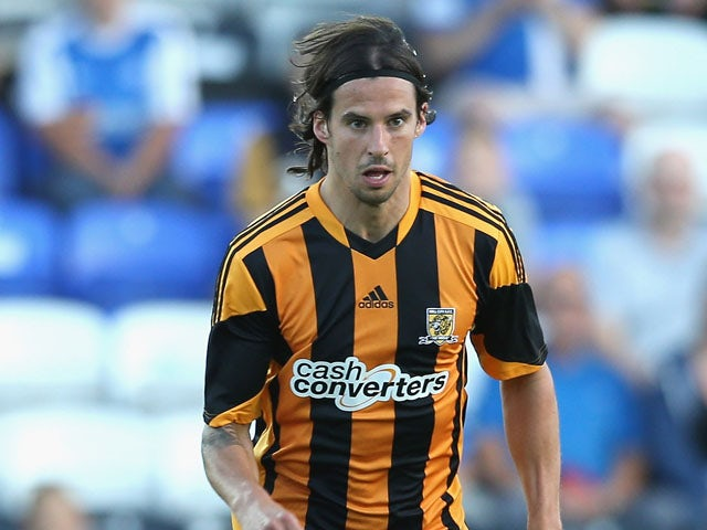 George Boyd of Hull City runs with the ball during the pre season friendly match between Peterborough United and Hull City at London Road Stadium on July 29, 2013