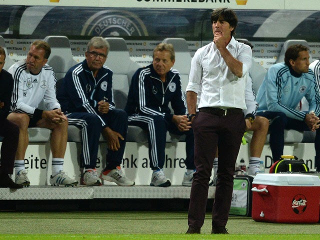 German head coach Joachim Loew reacts during the friendly football match Germany vs Paraguay on August 14, 2013