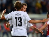 German striker Miroslav Klose and German midfielder Thomas Mueller celebrate scoring during the friendly football match Germany vs Paraguay on August 14, 2013