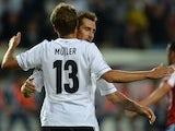 German striker Miroslav Klose and German midfielder Thomas Mueller celebrate scoring during the friendly football match Germany vs Paraguay on August 14, 2013