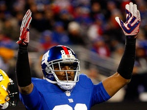 Wide receiver Hakeem Nicks #88 of the New York Giants reacts after scoring a touchdown in the third quarter against the Green Bay Packers at MetLife Stadium on November 25, 2012