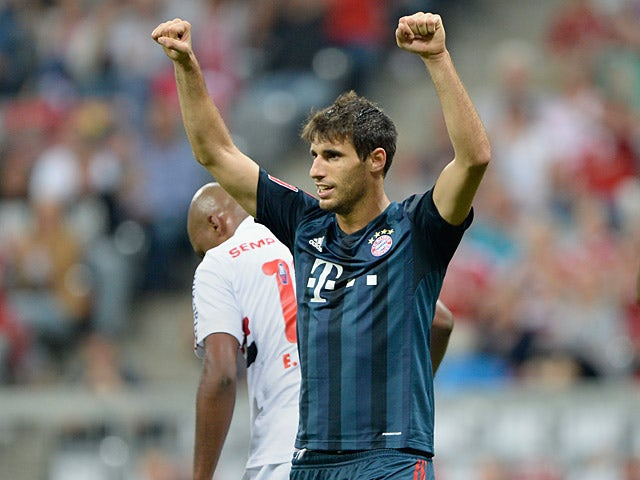 Bayern Munich's Javi Martinez celebrates after scoring in a friendly match against Sao Paulo on July 31, 2013