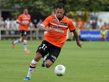 Lorient's French forward Jeremie Aliadiere runs with the ball during a French L1 friendly football match between Lorient and Rennes on July 24, 2013