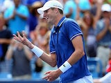 John Isner celebrates his win over Novak Djokovic during the Western & Southern Open on August 16, 2013