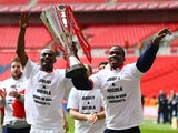 Abdul Osman and Chuks Aneke of Crewe Alexandra celebrates with the trophy during the Johnstone's Paint Trophy Final match between Crewe Alexandra and Southend United at Wembley Stadium on April 7, 2013