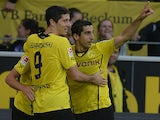 Borussia Dortmund's Jonas Hofmann is congratulated by team mates Robert Lewandowski and Henrikh Mkhitaryan after scoring the opening goal against Eintracht Braunschweig on August 18, 2013