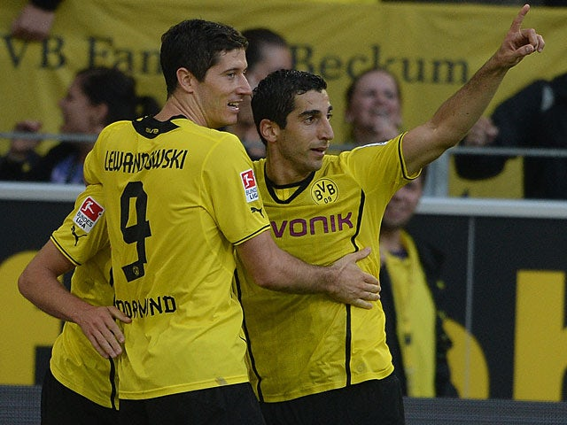 Borussia Dortmund's Jonas Hofmann is congratulated by team mates Robert Lewandowski and Henrikh Mkhitaryan after scoring the opening goal against Eintracht Braunschweig on August 18, 2013