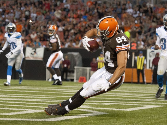 Tight end Jordan Cameron #84 of the Cleveland Browns catches a touchdown pass during the first half of a preseason at FirstEnergy Stadium on August 15, 2013