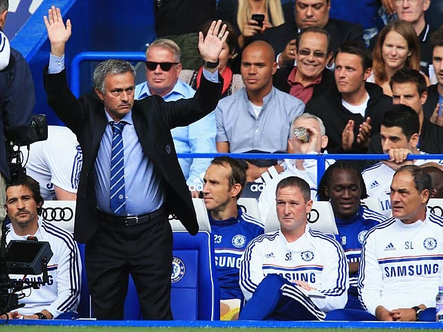 Chelsea manager Jose Mourinho waves to the crowd as he is welcomed back Chelsea fans before kick off against Hull on August 18, 2013