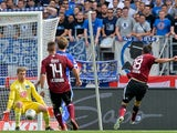 Nuremberg's Josip Drmic scores his team's opening goal against Hertha Berlin on August 18, 2013
