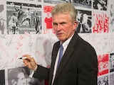 Former Bayern Munich headcoach Jupp Heynckes signs a wall during a ceremony for the 50th anniversary of the German football premier league Bundesliga on August 6, 2013