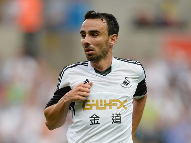 Leon Britton of Swansea in action during the UEFA Europa League third round qualifying first leg match between Swansea City and Malmo at the Liberty Stadium on August 1, 2013
