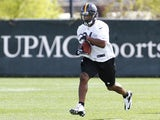 Le'Veon Bell #26 of the Pittsburgh Steelers participates in drills during Rookie Camp on May 3, 2013