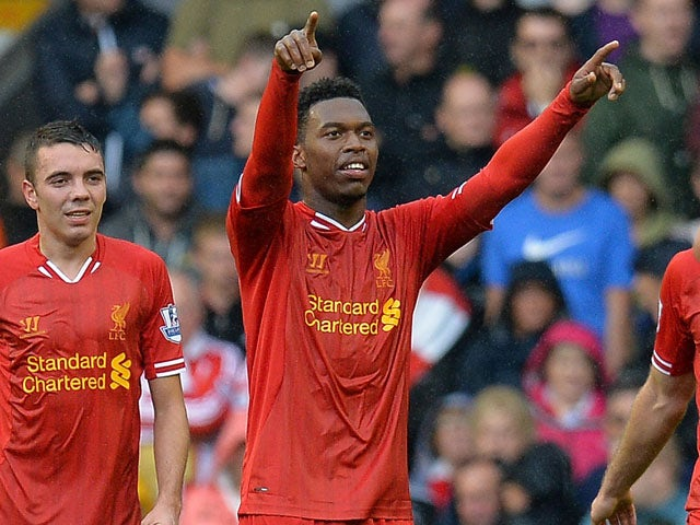 Liverpool's English forward Daniel Sturridge celebrates after scoring his team's first goal during the season's opening English Premier League football match between Liverpool and Stoke City on August 17, 2013