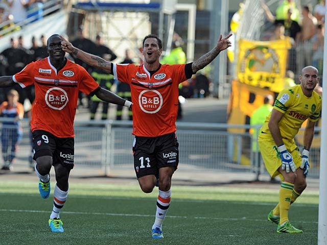 Lorient's Jeremie Aliadiere celebrates after scoring his team's second goal against Nantes on August 18, 2013