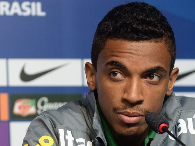 Brazil's midfielder Luiz Gustavo listens to comments during a press conference in Rio de Janeiro on June 28, 2013