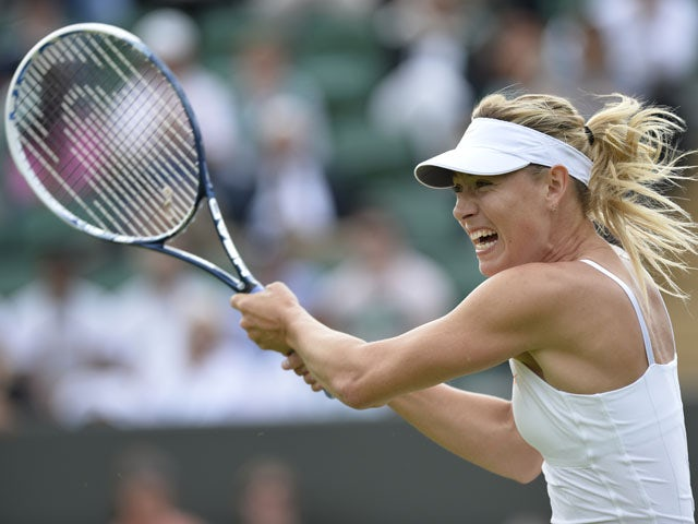 Russia's Maria Sharapova returns against Portugal's Michelle Larcher De Brito during their second round women's singles match on day three of the 2013 Wimbledon Championships tennis tournament at the All England Club in Wimbledon, southwest London, on Jun
