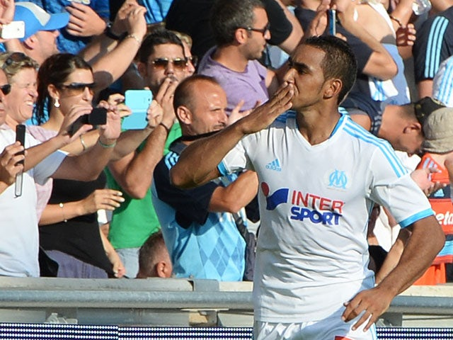 Marseille's French forward Dimitri Payet celebrates after scoring his team's second goal during the French L1 football match between Olympique of Marseille and Evian at the Velodrome stadium in Marseille, on August 17, 2013