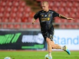 Martin Skrtel runs with the ball during a Liverpool FC training session at Rajamangala Stadium on July 27, 2013