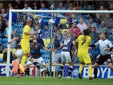 James Vaughan of Huddersfield scores the opening goal during the Sky Bet Championship match between Millwall and Huddersfield Town at The Den on August 17, 2013