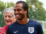 Nathan Delfouneso and FA Chairman David Bernstein attend an England training with local school children on June 9, 2013