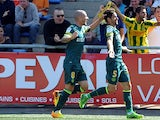 Nantes' Olivier Veigneau celebrates after scoring the opening goal against Lorient on August 18, 2013