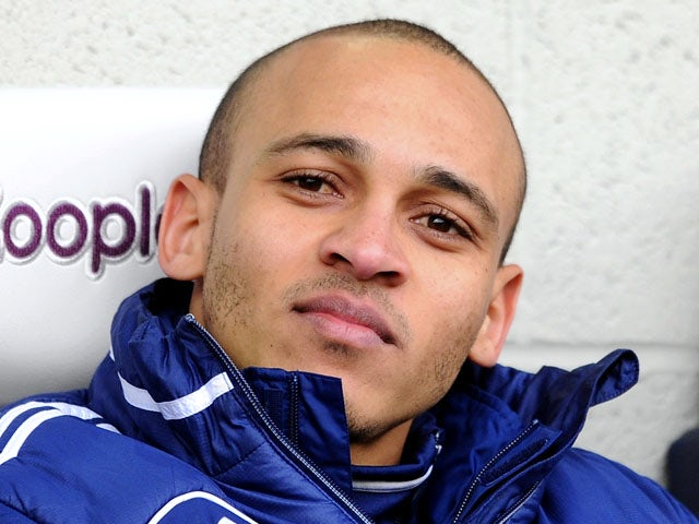 Peter Odemwingie of West Bromwich Albion looks on from the bench during the Barclays Premier League match between West Bromwich Albion and Sunderland at The Hawthorns on February 23, 2013