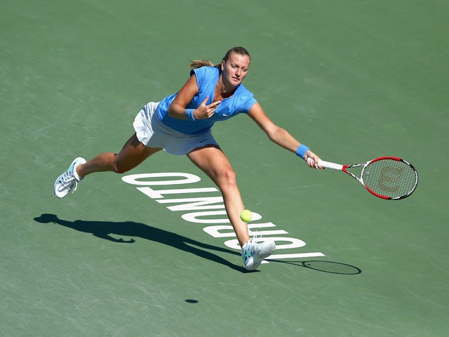 Petra Kvitova of the Caech Republic hits a return during her 6-4, 5-7,2-6 loss to Sorana Cirstea of Romania during the Rogers Cup Toronto on day 5 at Rexall Centre at York University on August 9, 2013
