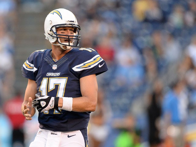 Philip Rivers of the San Diego Chargerslooks back at the bench for a play against the Seattle Seahawks at Qualcomm Stadium on August 8, 2013