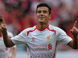 English Premier League football club Liverpool player Philippe Coutinho celebrates after scoring against Thailand at Rajamangala National Stadium in Bangkok on July 28, 2013