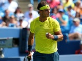 Rafael Nadal celebrates after winning a point against John Isner during the men's final of the Western & Southern Open on August 18, 2013