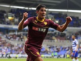 Marco Faraoni of Watford celebrates after scoring the teams first goal during the Sky Bet Championship match between Reading v Watford at The Madejski Stadium on August 17, 2013
