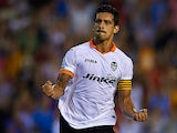 Valencia's Ricardo Costa celebrates scoring against Malaga on August 17, 2013