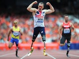 Richard Whitehead of Great Britain celebrates as he crosses the line first in the Men's T42 200mduring day three of the Sainsbury's Anniversary Games - IAAF Diamond League 2013 at The Queen Elizabeth Olympic Park on July 28, 2013