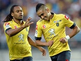 Sochaux's Ryad Boudebouz is congratulated by team mate Yassin Mikari after scoring the opening goal against Lyon on August 16, 2013