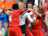 Liverpool goalkeeper Simon Mignolet is congratulated by team mates after saving a penalty against Stoke on August 17, 2013