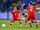 Brazilian forward Neymar is tackled during the International Friendly against Switzerland on August 14, 2013