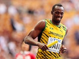 Jamaica's Usain Bolt smiles as he crosses the finish line to win gold in the Men's 4x100 metres at the World Championships in Moscow on August 18, 2013