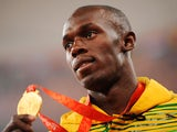 Jamaica's gold medalist Usain Bolt poses on the podium a day after winning the men's 100m at the National stadium as part of the 2008 Beijing Olympic Games on August 17, 2008.