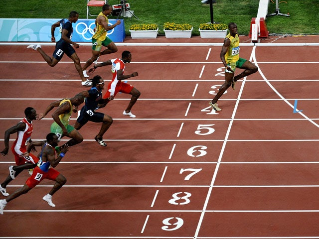 Jamaica's Usain Bolt crosses the finish line to win the men's 100m final at the 2008 Olympic Games on August 16, 2008