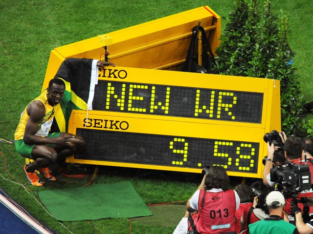 Jamaica's Usain Bolt celebrates winning the men's 100m final race of the 2009 IAAF Athletics World Championships and setting a new World Record time on August 16, 2009