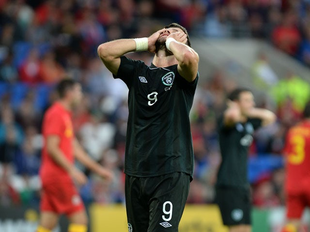 Ireland number 9 Shane Long shows his frustration after missing a shot on goal during the International Friendly match between Wales v Ireland at the Cardiff City Stadium on August 14, 2013