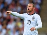 Wayne Rooney of England gestures during the International Friendly match between England and Scotland at Wembley Stadium on August 14, 2013