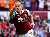 Joe Cole of West Ham United celebrates his goal during the Barclays Premier League match between West Ham United and Cardiff City at the Bolyen Ground on August 17, 2013