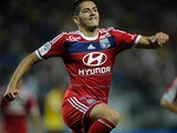 Lyon's Yassine Benzia celebrates after scoring the equaliser against Sochaux on August 16, 2013