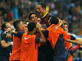 Barca's Adriano is congratulated by teammates after a goal against Malaga on August 25, 2013