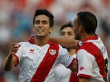 Rayo's Alberto Bueno celebrates with teammates after scoring against Elche on August 19, 2013