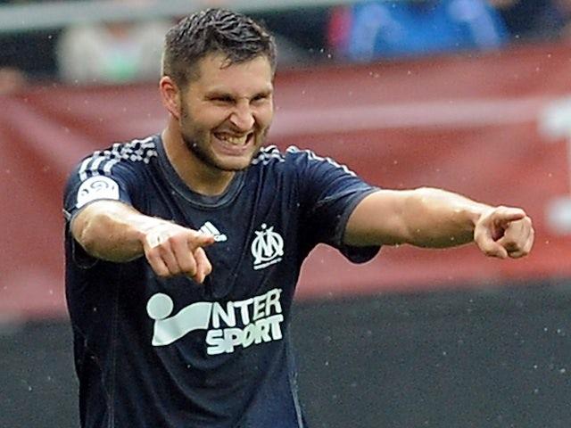 Marseille striker Andre-Pierre Gignac celebrates scoring against Valenciennes on